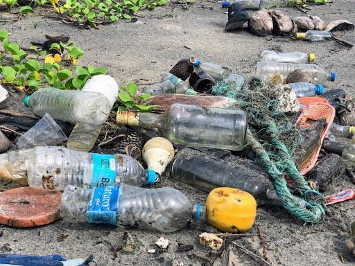 photo of rubbish scattered on beach