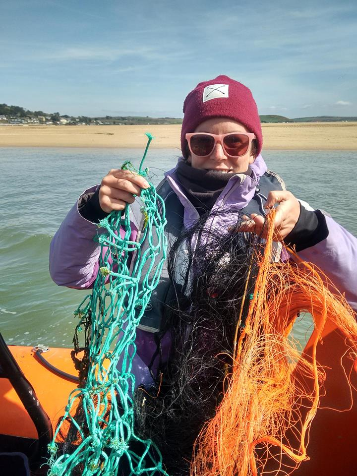 Jenny picking up 'ghost gear'. Old fishing nets that are drifting needlessly in our oceans.