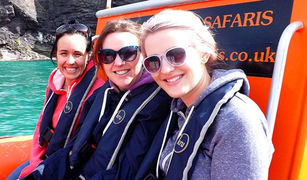 Three people smiling on Padstow Sealife Safari